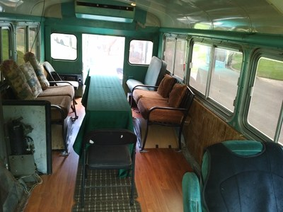 RPG Bus Interior with tables, chairs.
